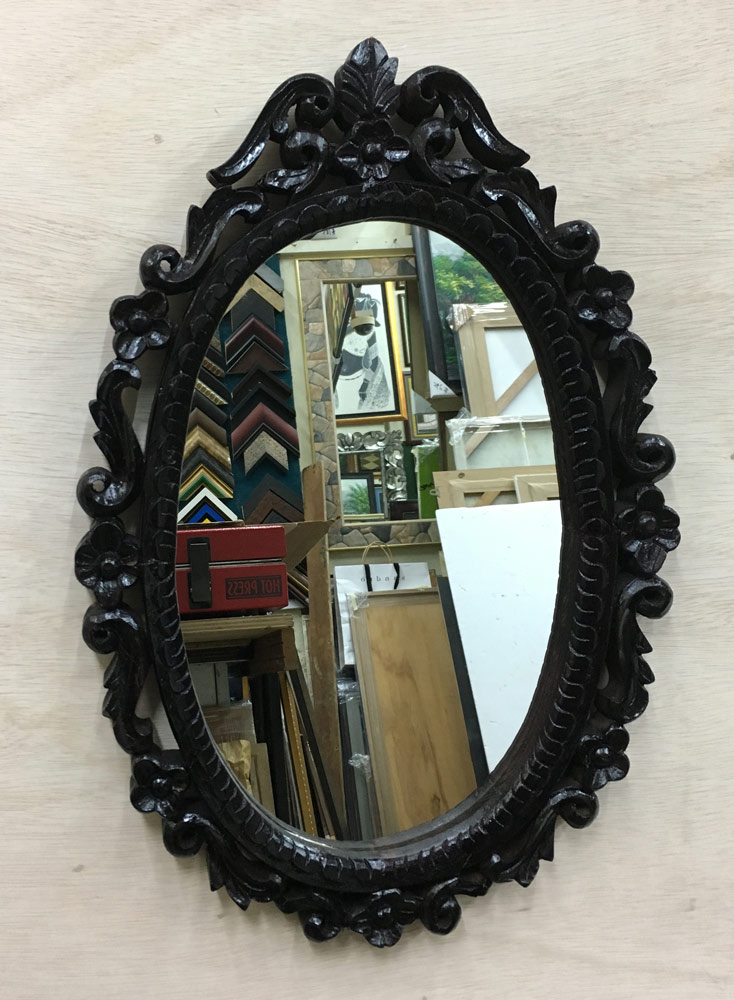 Solid curve wood mirror